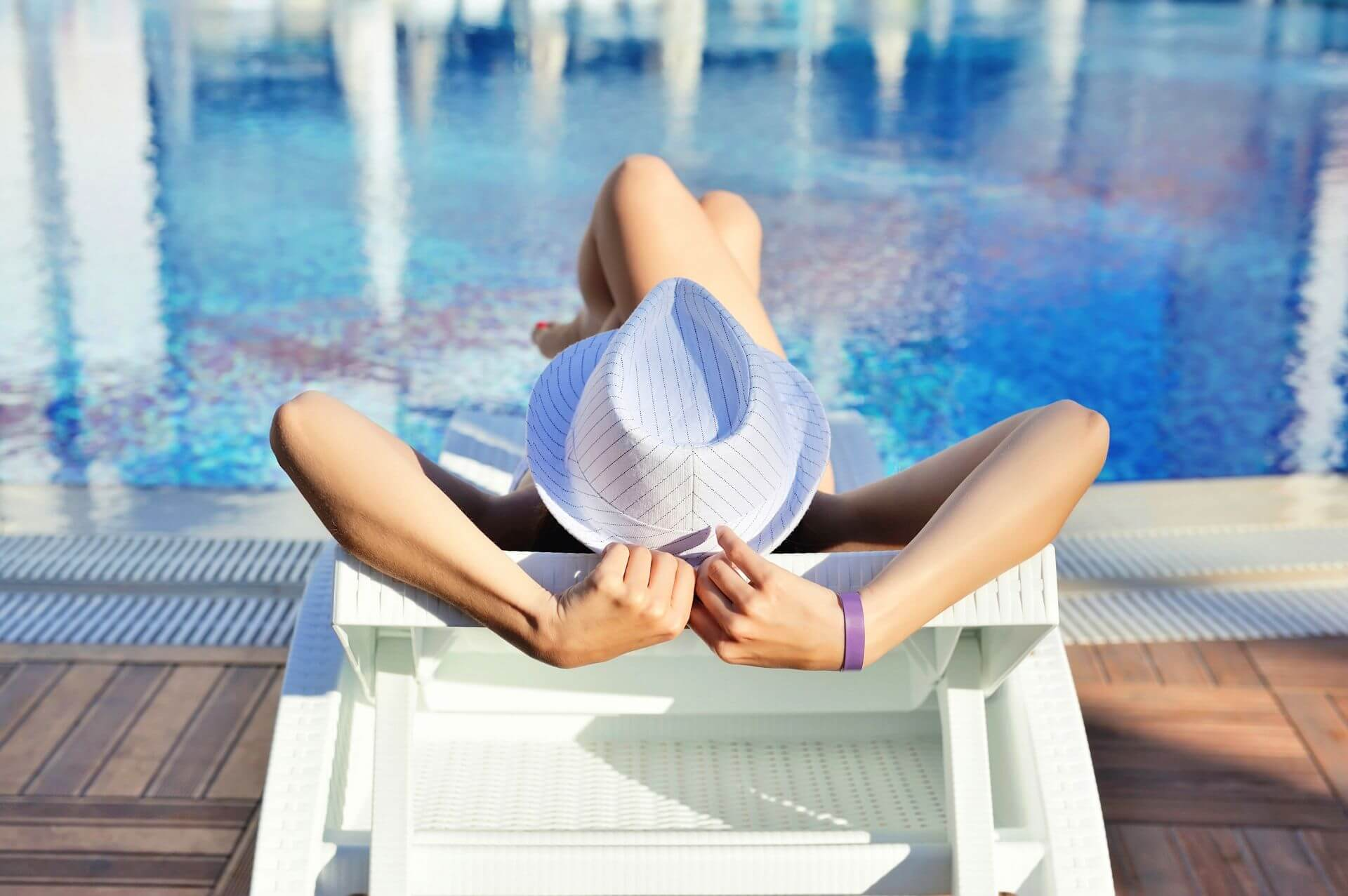 content/woman-in-white-hat-lying-on-a-lounger-near-the-p9zlee2.jpg